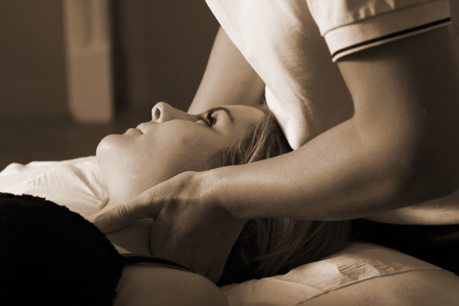Woman receiving Manipulation treatment
