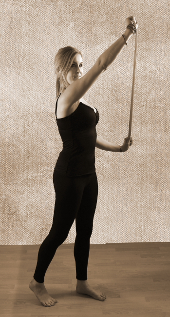 Woman exercising with a Theraband